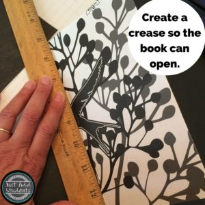 Upcycle school supplies to create a fun notebook or journal.